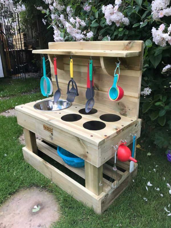 Side View Of Classic Mini Mud Kitchen