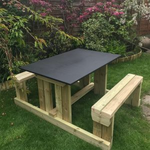 Wooden Chalk Board Picnic Table In Garden