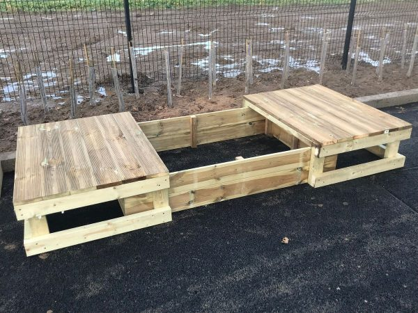 Large Dual Wooden Sandpit And Stage In Playground