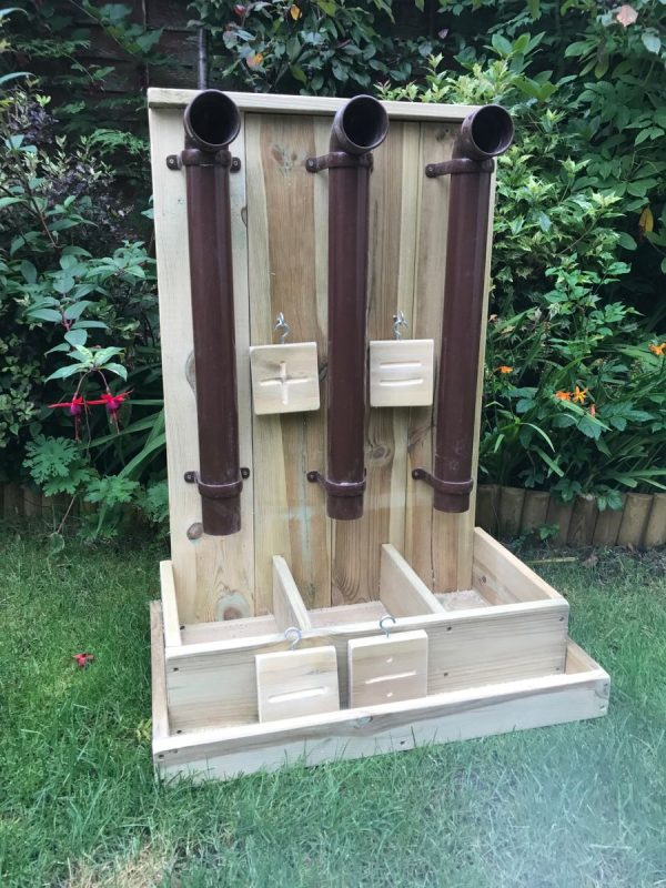 Wooden Adding Machine And Posting Pipes In Garden