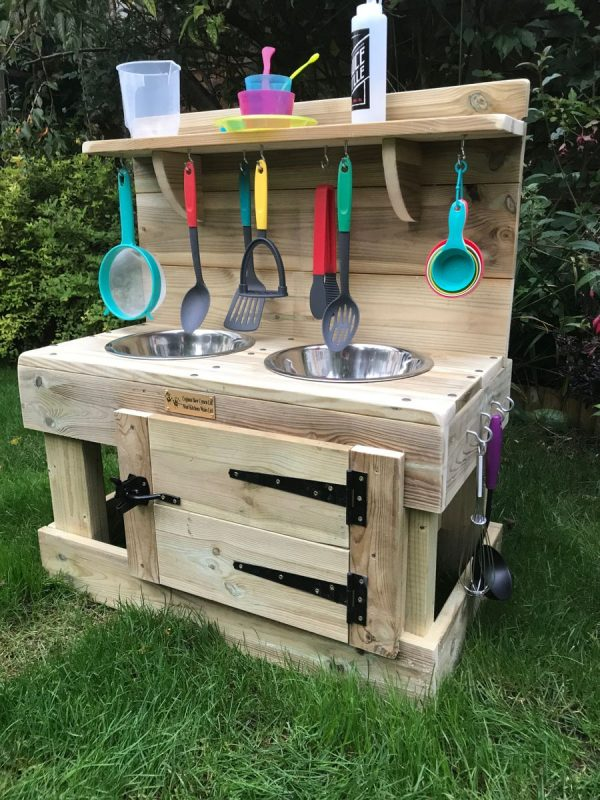 Mud Kitchen Sitting On Grass
