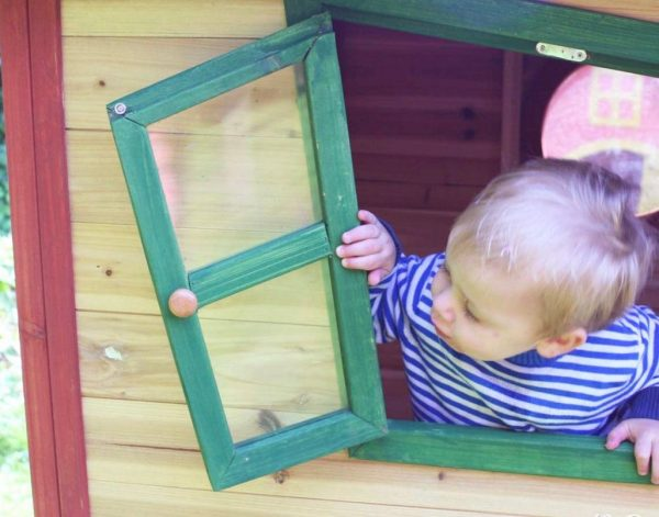 Child Looking Out Of Playhouse Window