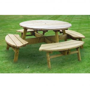 Round Wooden Picnic Table On Grass