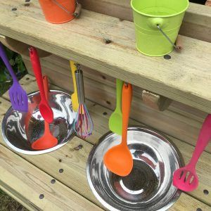 Close Up Of Mud Kitchen Tools And Buckets