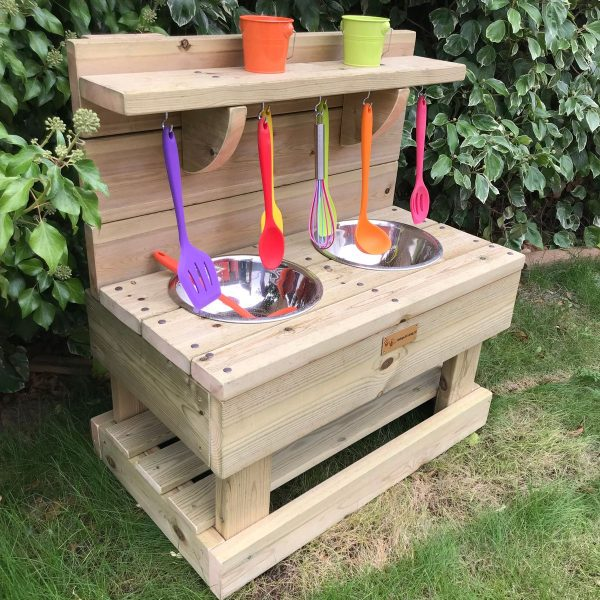 Side View Of Small Wooden Mud Kitchen