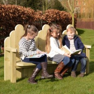 Children Sitting On Wooden Story Bench