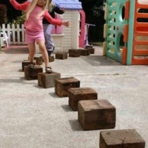 Girl Playing On Wooden Blocks