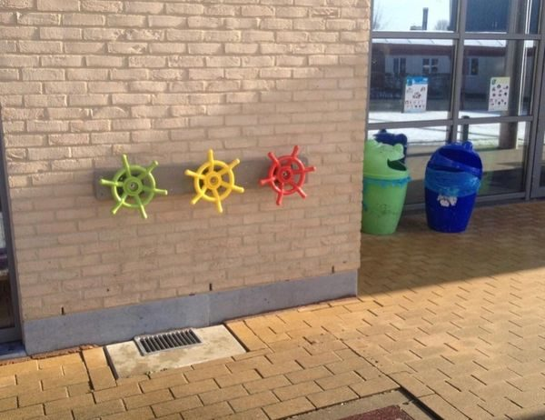 Different Coloured Wheels On Wall