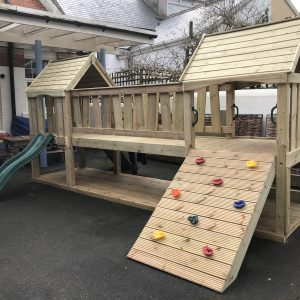 Wooden Play Area For Kids With Climbing Wall