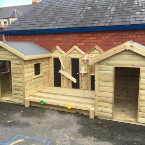Wooden Playhouse In Playground